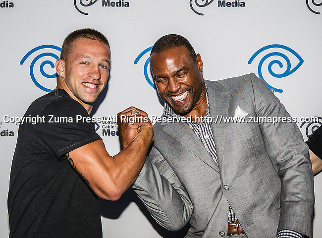 Ray Molinere and Darren Woodson at the Time Warner Media Cabletime Upfront media event held at the Private Social Restaurant  in Dallas, Texas.