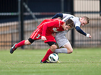 Ian Christianson (6) of Georgetown fights for the ball with Brandon Savino (3) of St. John's during the game at North Kehoe Field in Washington DC. Georgetown defeated St. John's, 2-1, in the Big East conference tournament quarterfinals.