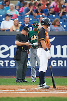 Lynchburg Hillcats manager Mark Budzinski (7) goes over the lineup with umpire Chris Scott as Austin Bailey bats out of order during a game against the Wilmington Blue Rocks on June 3, 2016 at Judy Johnson Field at Daniel S. Frawley Stadium in Wilmington, Delaware.  Lynchburg defeated Wilmington 16-11 in ten innings.  (Mike Janes/Four Seam Images)