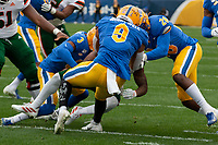 PItt defensive back Damar Hamlin (3), linebacker Saleem Brightwell (9) and  linebacker Kylan Johnson (28) gang tackler a Miami Hurricanes runner. The Miami Hurricanes football team defeated the Pitt Panthers 16-12 in a game at Heinz Field, Pittsburgh, Pennsylvania on October 26, 2019.