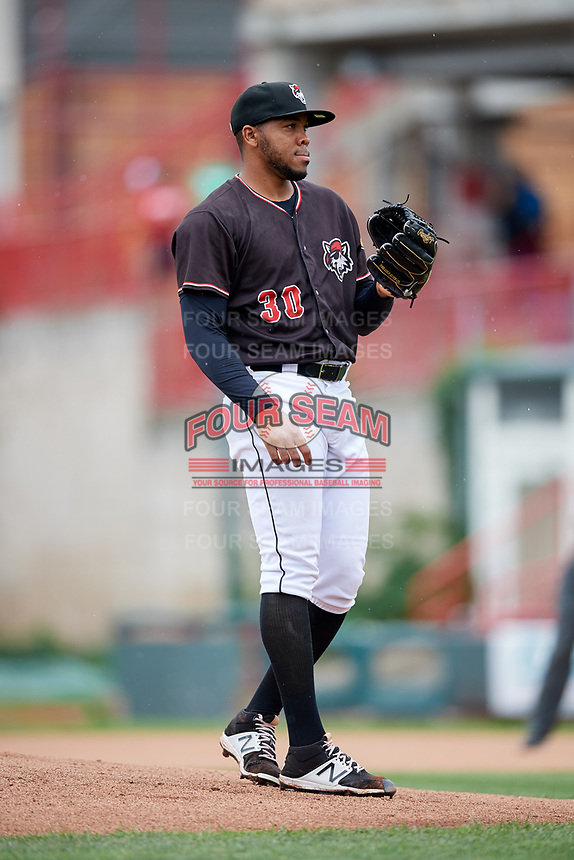Erie SeaWolves starting pitcher Sandy Baez (30) waits to receive the ball back from the catcher during a game against the New Hampshire Fisher Cats on June 20, 2018 at UPMC Park in Erie, Pennsylvania.  New Hampshire defeated Erie 10-9.  (Mike Janes/Four Seam Images)