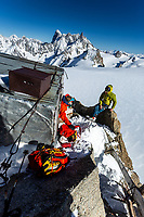 Tom Livingstone outside the old Perroux Hut, Chamonix, Alps, Mont Blanc Massif, France