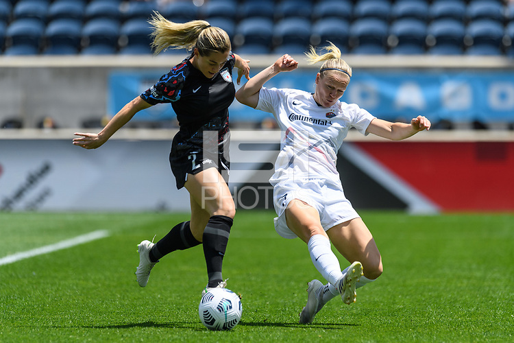 BRIDGEVIEW, IL - JUNE 5: Kealia Watt #2 of the Chicago Red Stars and Diane Caldwell #7 of the North Carolina Courage battle for the ball during a game between North Carolina Courage and Chicago Red Stars at SeatGeek Stadium on June 5, 2021 in Bridgeview, Illinois.