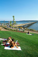 Summer Recreational Activities at White Rock, BC, British Columbia, Canada - People sunbathing at White Rock Pier along Seaside Promenade Walkway and Semiahmoo Bay
