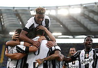 Calcio, Serie A: Lazio vs Juventus. Roma, stadio Olimpico, 27 agosto 2016.<br /> Juventus' Sami Khedira, center, back to camera, celebrates with teammates after scoring the winning goal during the Serie A soccer match between Lazio and Juventus, at Rome's Olympic stadium, 27 August 2016. Juventus won 1-0.<br /> UPDATE IMAGES PRESS/Isabella Bonotto