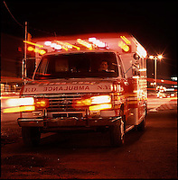 Ambulance with emergency lights on<br />
