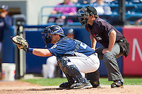 West Michigan Whitecaps catcher Bennett Pickar (25) sets a target as home plate umpire Ryan Simmons looks on during the Midwest League game against the Quad Cities River Bandits at Fifth Third Ballpark on May 5, 2013 in Comstock Park, Michigan.  The River Bandits defeated the Whitecaps 5-4.  (Brian Westerholt/Four Seam Images)