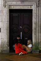 Pictured: Two young women sit in a door frame in Wind Street, Swansea, Wales, UK. Friday 20 December 2019<br /> Re: Black Eye Friday (also known as Black Friday, Mad Friday, Frantic Friday) the last Friday before Christmas, in Swansea, Wales, UK.
