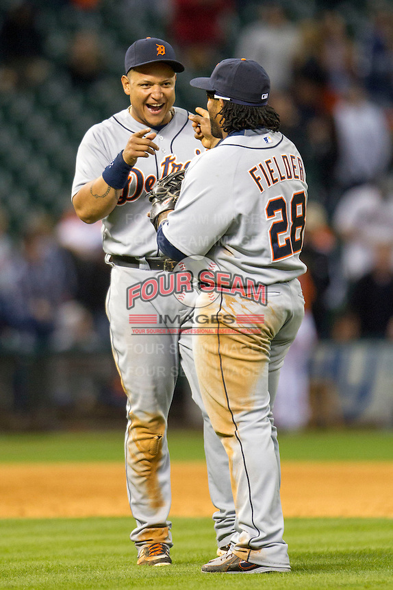 Detroit Tigers third baseman Miguel Cabrera (24) and first baseman Prince Fielder (28) celebrate after the Tigers won their MLB baseball game against the Houston Astros on May 3, 2013 at Minute Maid Park in Houston, Texas. Detroit defeated Houston 4-3. (Andrew Woolley/Four Seam Images).