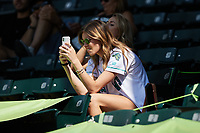 A Lynchburg Hillcats fan uses her smart phone to capture images during the minor league baseball game against the Myrtle Beach Pelicans at Bank of the James Stadium on May 23, 2021 in Lynchburg, Virginia. (Brian Westerholt/Four Seam Images)