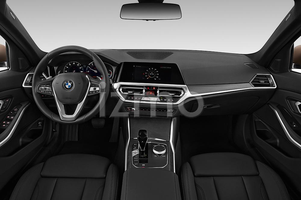Stock photo of straight dashboard view of a 2019 BMW 3-Series  Sport 4 Door Sedan