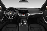 Stock photo of straight dashboard view of a 2019 BMW 3-Series  Sport 4 Door Sedan