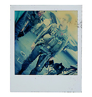 """BNPS.co.uk (01202) 558833. <br /> Pic: PropStore/BNPS<br /> <br /> Pictured: A continuity Polaroid photograph of Tim Robbins as """"Merlin"""" is included in the sale. <br /> <br /> Costume props and behind-the-scenes photos from the classic Tom Cruise movie Top Gun are coming up for sale.<br /> <br /> The archive includes the white vest worn by Goose, the partner of Tom Cruise's character Pete 'Maverick' Mitchell, during the famous beach volleyball scene. <br /> <br /> There is also the flight suit worn by Maverick's Top Gun rival, Tom 'Iceman' Kazansky, played by Val Kilmer in the 1986 film."""