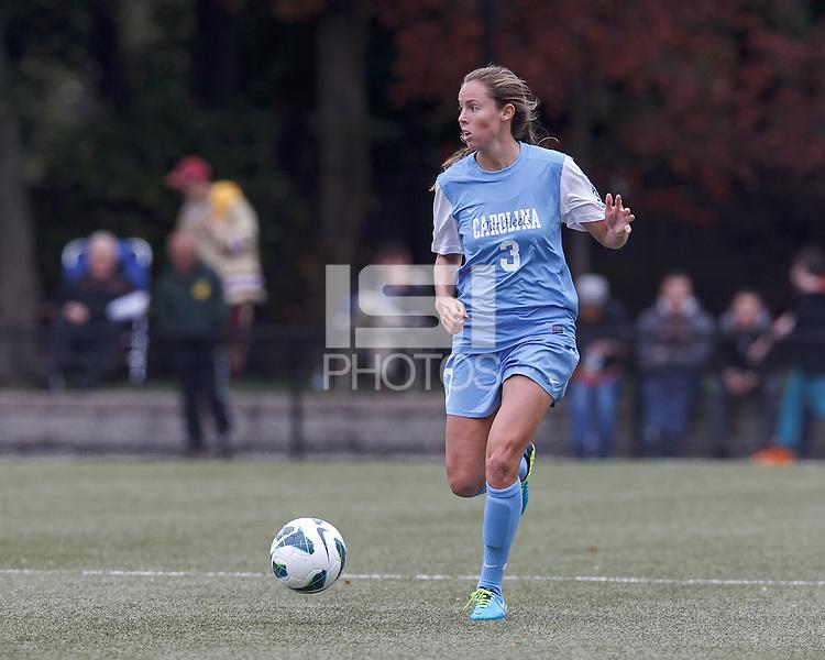 University of North Carolina defender Megan Brigman (3) looks to pass.  University of North Carolina (blue) defeated Boston College (white), 1-0, at Newton Campus Field, on October 13, 2013.