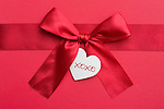 Red ribbon with heart-shaped tag