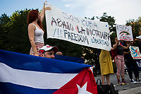 NEW YORK, NEW YORK - JULY 14: Men and women with flags and banners gather in support of Cuban protesters in Union Square Park on July 14, 2021 in New York City. A small group of people gathered in Union Square Park in support of the Cuban people who have been protesting against the communist regime due to food shortages and the worsening of the economic crisis that has been exasperated by the coronavirus pandemic (COVID-19) . The protest on the island has been the largest protest against the government in decades. (Photo by Pablo Monsalve / VIEWpress via Getty Images)
