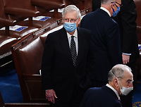 United States Senate Majority Leader Mitch McConnell (Republican of Kentucky) arrives for the Electoral College vote certification for President-elect Joe Biden, during a joint session of Congress at the U.S. Capitol in Washington, DC on Wednesday, January 6, 2021.<br /> CAP/MPI/RS<br /> ©RS/MPI/Capital Pictures