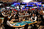 Dealers wait for players in the 25K Heads Up tournament area.