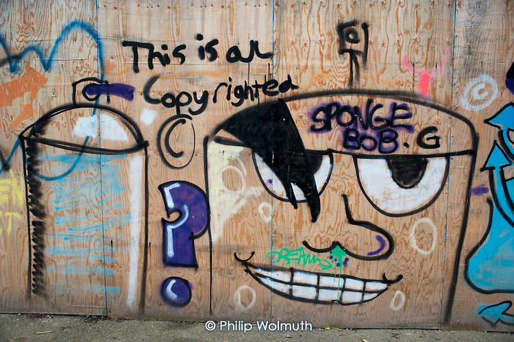 This Is All Copyrighted.  Graffiti on a construction site hoarding in West Hampstead, London.