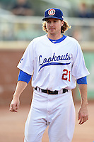 Chattanooga Lookouts pitcher Tyson Brummett (21) walks to the dugout during a game against the Birmingham Barons on April 24, 2014 at AT&T Field in Chattanooga, Tennessee.  Chattanooga defeated Birmingham 5-4.  (Mike Janes/Four Seam Images)