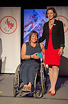 Calgary, AB - June 5 2014 - Ina Forrest receives her Paralympic ring from Monique Giroux, of CIBC, during the Celebration of Excellence Paralympic Ring Reception in Calgary. (Photo: Matthew Murnaghan/Canadian Paralympic Committee)
