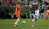 Sky Blue's Kacey White (20) attempts to block a blast by Chicago's Carli Lloyd (10).  Sky Blue defeated the Chicago Red Stars 1-0 in a mid-week game, Wednesday, June 17, at Yurcak Field.