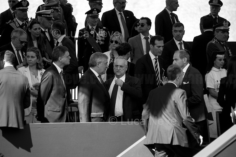 """(From L To R) Antonio Tajani (President of the European Parliament - Forza Italia) and Claudio Lotito (President of football team ss Lazio).<br /> <br /> Rome, 02/06/2019. Today, Italy celebrated the annual """"Festa Della Repubblica"""" (Republic Day, 1.). The 73rd Anniversary of the Italian Republic (*) was marked with the """"Raising the Flag Ceremony"""" and the tribute to the Sacello del Milite Ignoto (Unknown Soldier) at the Altare della Patria """"Vittoriano"""" (2.) by the President of the Italian Republic Sergio Mattarella, followed by the traditional army, veterans and civilians parade along Via Dei Fori Imperiali. This year, the President of the Republic was accompanied by the Defence Minister Elisabetta Trenta, the Italian Prime Minister Giuseppe Conte, the Presidents of the two Chambers of the Parliament, Roberto Fico and Maria Elisabetta Alberti Casellati, several members of the Italian Government, political leaders, senior officers of the Armed Forces and representatives of the Civilian Organizations. At the end of the events the Frecce Tricolori, the Italian Aerobatic Team, coloured the sky over Rome with the Tricolore (Tricolour: Green, White, Red) of the Italian Flag. The theme for this year's event was inclusiveness. <br /> <br /> Footnotes and Links:<br /> (*) The Referendum was held on 2 June 1946 and it marked the decision made by the Italian people to adopt the Republic as the new institutional form for the Country. <br /> 1. http://bit.do/eT8By (ITA) & http://bit.do/eT8Bv (ENG) at https://www.difesa.it/<br /> 2. http://bit.do/eT8BG (Wikipedia)"""