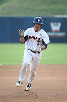 Aaron Burnett (7) of the Pepperdine Waves claps his hands while running the bases during a game against the Texas A&M Aggies at Eddy D. Field Stadium on February 26, 2016 in Malibu, California. Pepperdine defeated Texas A&M, 7-5. (Larry Goren/Four Seam Images)