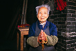 Senior woman with prayer beads; portrait; Cyunsi Buddhist Nunnery; commerce; religion; Chongqing, China, Asia; 041603