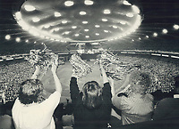 1987 FILE PHOTO - ARCHIVES -<br /> <br /> Roof takes limelight: Indoor baseball finally came to the Olympic Stadium in Montreal yesterday - 11 years late and at a cost of $117 million - and fans like these three whooped it up for the occasion. They didn't seem to care that; ironically; it was the warmest opening day since the team's first season in 1969. Expos lost their home opener to the Philadelphia Phillies; 4-3.<br /> <br /> PHOTO : Ron BULL - Toronto Star Archives - AQP
