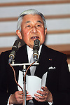December 23, 2012, Tokyo, Japan - Emperor Akihito reads a statement to a throng of well-wishers from behind the bullet-proof glass panel of the Imperial Palace balcony in Tokyo on Sunday, December 23, 2012. More than 20,000 well-wishers turned out to the palace, celebrating the 79th birthday of the monarch, who said in his statement that he's concerned about the country's aging population. (Photo by AFLO) UUK -mis-