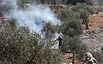 Palestinian protesters clash with Israeli troops during a demonstration against settlements in the village of Beita, near the West Bank city of Nablus on October 15, 2021. Photo by WAFA
