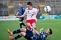 Stranraer's Jackson Longridge is challenged by Forfar's Dale Hilson.