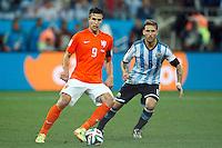 Robin van Persie of the Netherlands and Lucas Biglia of Argentina