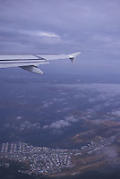 Airplane wing and land below<br />