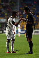 Thursday 29 August 2013<br /> Pictured L-R: Alejandro Pozuelo is protesting to match referee Michael Koukoulakis for being shown a yellow card by.<br /> Re: Petrolul Ploiesti v Swansea City FC UEFA Europa League, play off round, 2nd leg, Ploiesti, Romania.