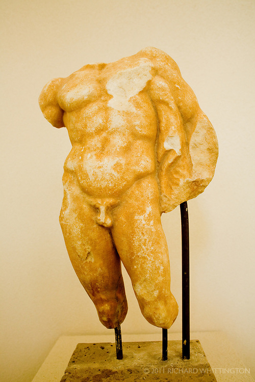 This weathered Greek statue can be found in the Olympia Archaeological Museum.