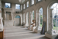 A collection of columns and caryatids is displayed in the double-height neo-classical orangery