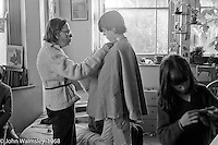 Sewing in the sewing teacher's own room, Summerhill school, Leiston, Suffolk, UK. 1968.  One of the boys trying on a cape he has made.