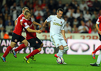 Pictured: Stephen Dobbie of Swansea (R) challenged by Tomasz Cywka of Barnsley (L). Tuesday 28 August 2012<br /> Re: Capital One Cup game, Swansea City FC v Barnsley at the Liberty Stadium, south Wales.