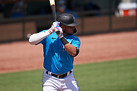 Miami Marlins Miguel Rojas (19) bats during a Major League Spring Training game against the Houston Astros on March 21, 2021 at Roger Dean Stadium in Jupiter, Florida.  (Mike Janes/Four Seam Images)