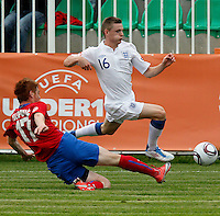 Alex Henshall (R) is challenged by Aleksandar Filipovic during the UEFA U-17 championship Group A match between Serbia and England on May 9, 2011 inn Indjija, Serbia (Photo by Srdjan Stevanovic/Starsportphoto.com)