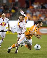 Houston Dynamo midfielder Brad Davis (11) and New York Red Bulls defender Seth Stammler (6) collide.  Houston Dynamo tied New York Red Bulls 0-0 at Robertson Stadium in Houston, TX onApril 11, 2009.