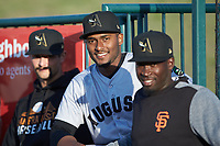 Augusta GreenJackets relief pitcher Franklin Van Gurp (center) prior to the game against the Greensboro Grasshoppers at First National Bank Field on April 10, 2018 in Greensboro, North Carolina.  The GreenJackets defeated the Grasshoppers 5-0.  (Brian Westerholt/Four Seam Images)
