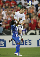 Heath Pearce #2 of the USA heads the ball away from Walter Martinez #15 of Honduras during a CONCACAF Gold Cup match at RFK Stadium on July 8 2009 in Washington D.C. USA won 2-0.