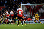 Doncaster Rovers v Leeds United<br /> 14.12.2013<br /> Sky Bet Championship<br /> Picture Shaun Flannery/Trevor Smith Photography<br /> Matt Smith (on ground) scores the first goal for Leeds United.