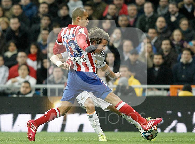 Real Madrid's Fabio Coentrao (b) and Atletico de Madrid's Joao Miranda during La Copa match.February 5,2014. (ALTERPHOTOS/Acero)