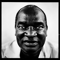 Roger Manono, doctor: 'When I became the hospital director, ministers came and visited me there. Why did I always wear jeans and a T-shirt? I have my doctor's coat. That should be enough. This country is a building site full of mud. Is it really necessary now to wear expensive suits and shiny shoes?  And all those politicians with their 40,000-dollar jeeps. Kabila's first official visit was to this hospital. And his wife came here without a bodyguard, and his son. I became friendly with him, ha! No, I do not need an  umbrella because if you lose it you are left standing in the rain. It can rain here, in buckets! The only real umbrella is the job. This country needs hard workers. That's why I came back here after training in Belgium. Unfortunately, I am well past 20.' .