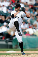 Chicago White Sox Will Ohman #77 during a game against the Kansas City Royals at U.S. Cellular Field on August 14, 2011 in Chicago, Illinois.  Chicago defeated Kansas City 6-2.  (Mike Janes/Four Seam Images)