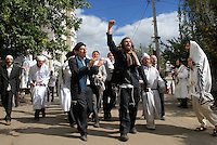 UKRAINE, Uman, 2008/09..Hasidic pilgrims make their way down Pushkin street to the prayers rooms. Thousands of Hasidic Jews from around the world gather in the Ukrainian city of Uman for a yearly pilgrimage marked by singing, dancing and prayer. .© Cyril Horiszny / EST&OST